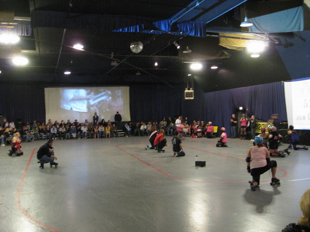 Rollergirls take a knee as a player is injured