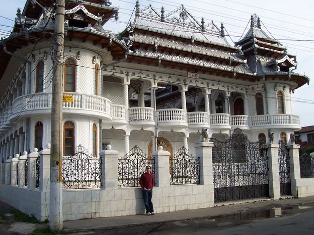 Brandon in front of a gypsy house